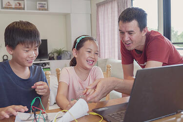 Teacher helps students with electronics and technology